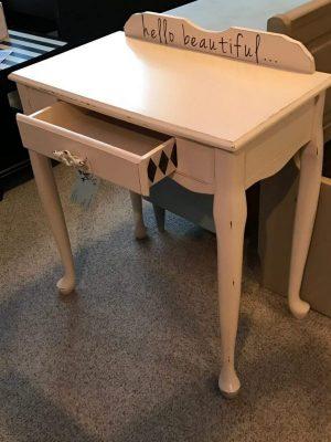 desk repurposed as vanity
