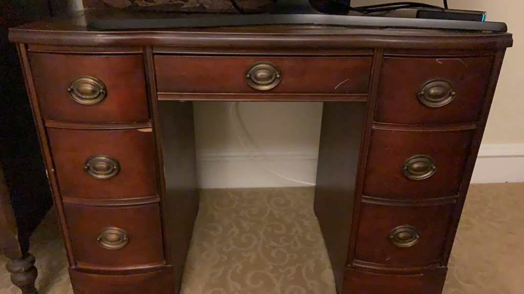 Dark mahogany stained desk