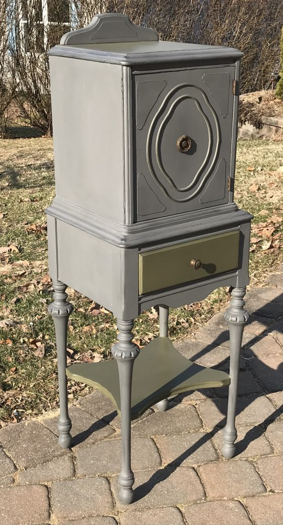 Painted antique storage cabinet with shelf