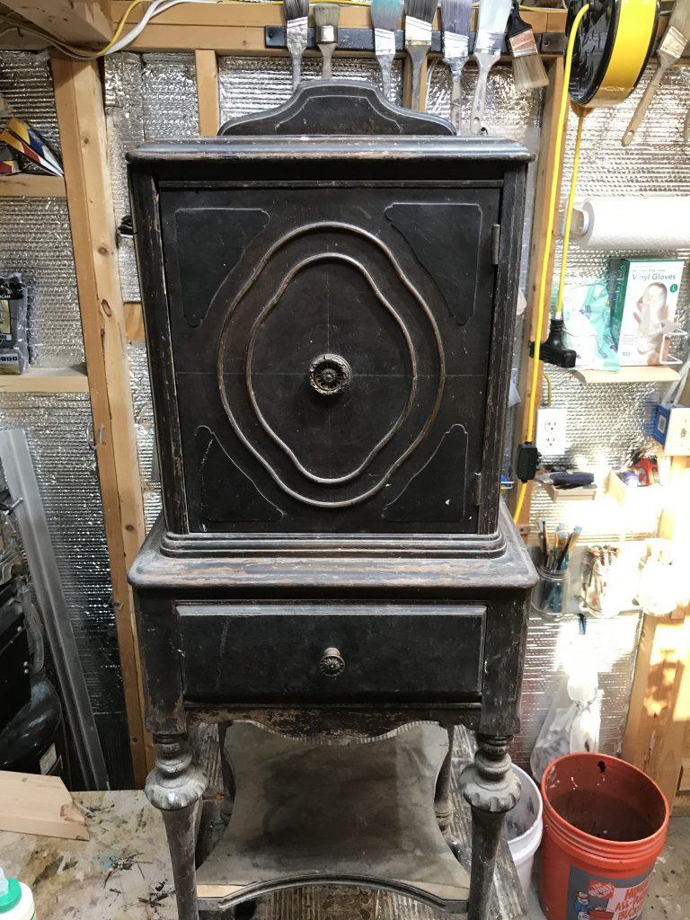 Brown antique storage cabinet with shelf