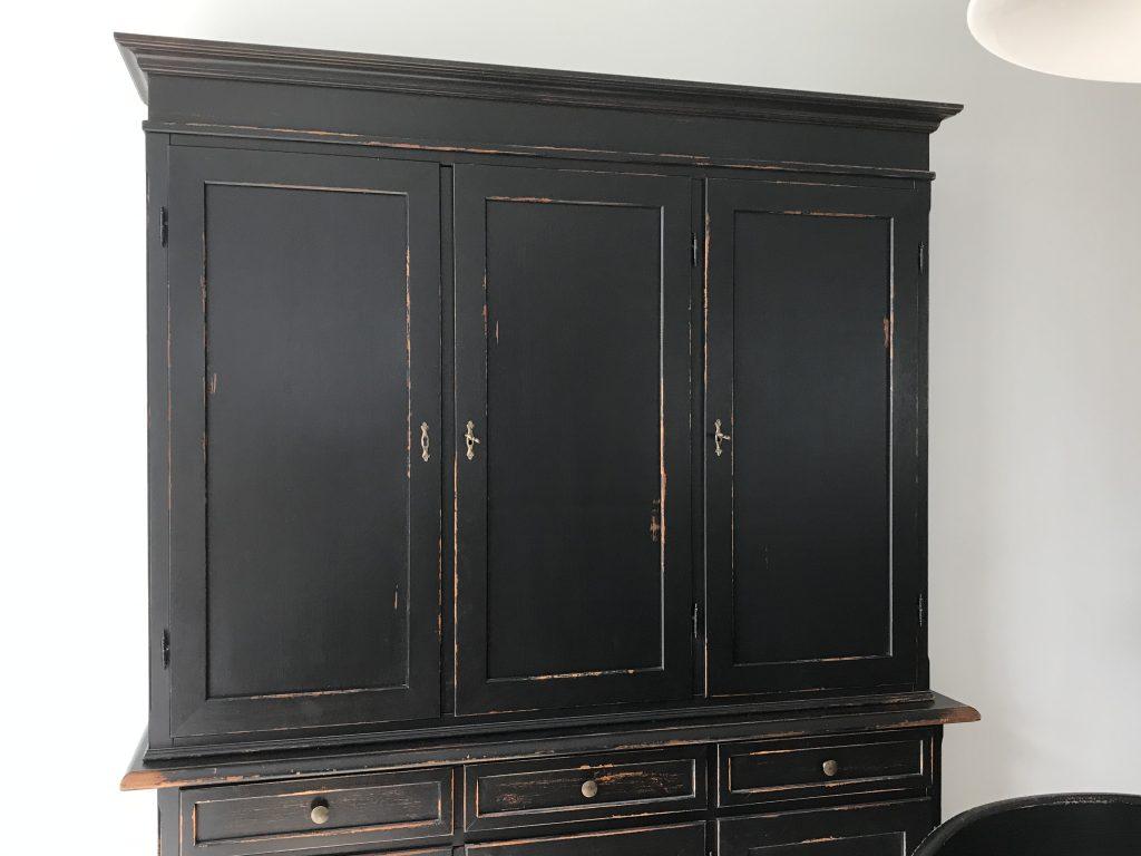 Black hutch with wooden doors