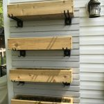Vertical Garden -Cedar planters mounted vertically to the side of the house