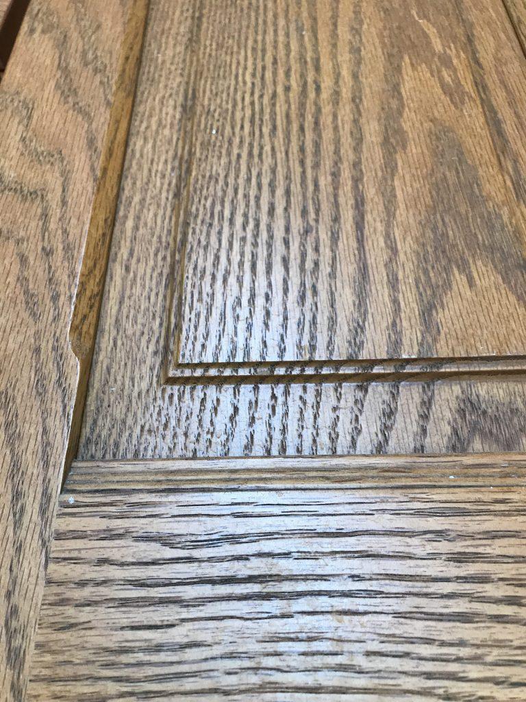 Builder grade oak bathroom vanity before