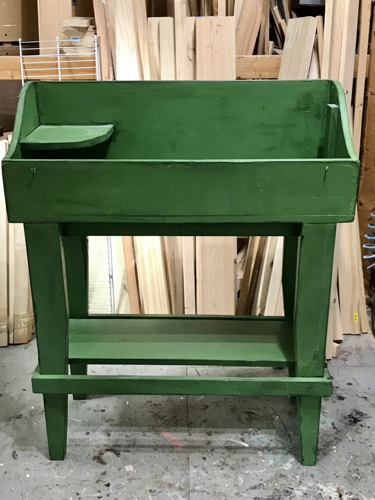 Green dry sink/potting bench before