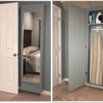 Ironing board cabinet with mirror