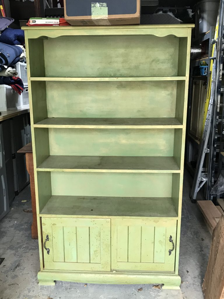 Green bookcase before makeover