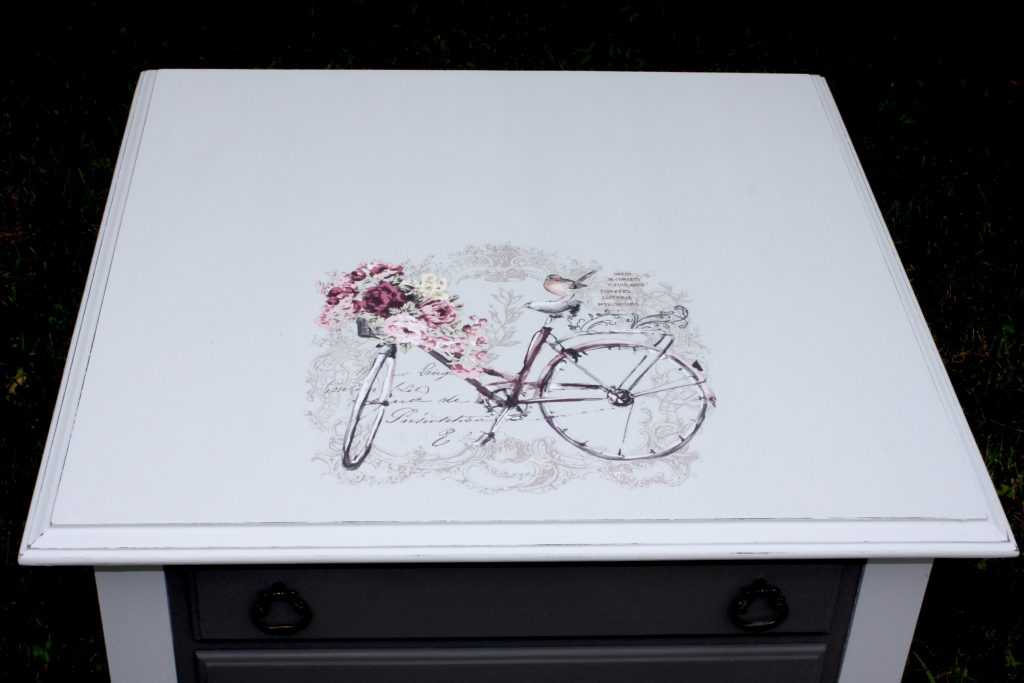 End table, light and dark gray with bicycle image