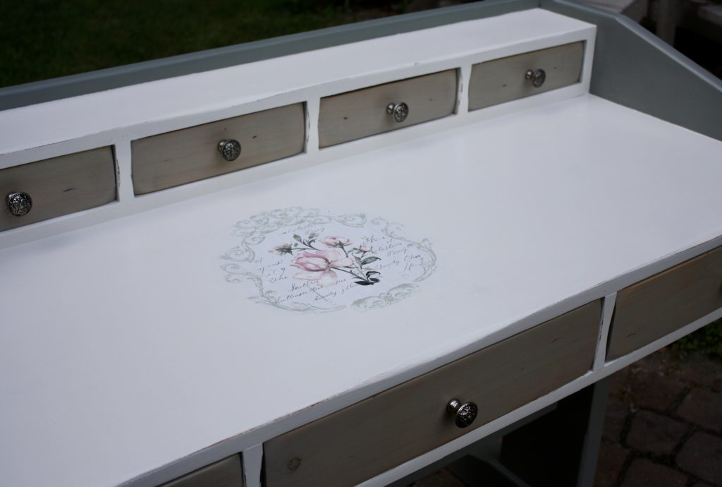 Feminine trestle style desk in soft white and gray-green with vintage accent